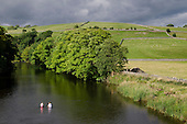 Two children swim in the river Wharfe in Burnsall, Yorkshire Dales National Park.