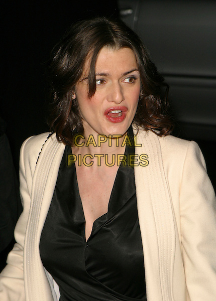 RACHEL WEISZ.The London Party, Spencer House, .27 St James's Place, London, England, .February 18th 2006..half length funny face mouth .Ref : AH.www.capitalpictures.com.sales@capitalpictures.com.©Adam Houghton/Capital Pictures.