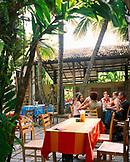 SRI LANKA, Asia, Colombo, friends sitting in Barefoot Cafe in Colombo.