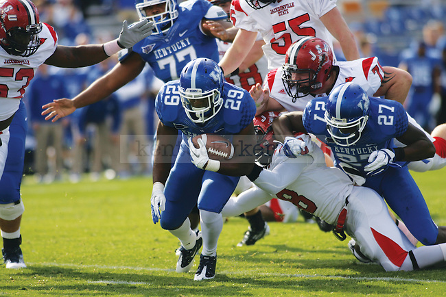 UK tail back Brandon Gainer carries the ball during the second half of UK's home game against Jacksonville State in Commonwealth Stadium in Lexington, Ky. on 10/22/11. Photo by Quianna Lige | Staff