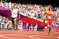 07.09.2012 London, England. Olympic Stadium.Men's 200m T12 Round 1 Heat 3 . Ahmed Abdul Amir Khadhim (IRQ)  and G  Desgarrega  Puigdevall (ESP) in action on Day 9 of the Paralympics from the Olympic Stadium...