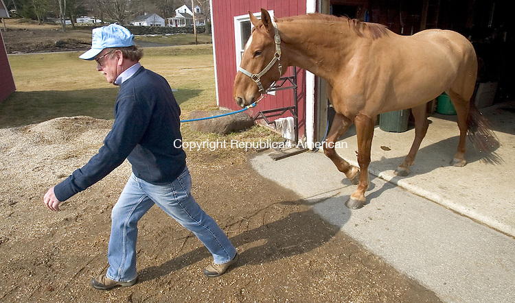 BRIDGEWATER, CT. 14 March 2007--15_NEW_031407SV02--First Selectman Bill Stuart of Bridgewater works with &quot;Lucky&quot; a Canadian Warm Blood at his farm in Bridgewater Wednesday.<br /> Steven Valenti Republican-American