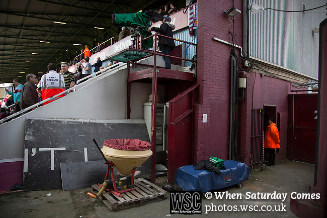 West Ham United 2 Crystal Palace 2, 02/04/2016. Boleyn Ground, Premier League. Building materials stored at the corner of the Bobby Moore Stand at the Boleyn Ground before West Ham United hosted Crystal Palace in a Barclays Premier League match. The Boleyn Ground at Upton Park was the club's home ground from 1904 until the end of the 2015-16 season when they moved into the Olympic Stadium, built for the 2012 London games, at nearby Stratford. The match ended in a 2-2 draw, watched by a near-capacity crowd of 34,857. Photo by Colin McPherson.