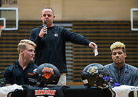 NWA Democrat-Gazette/BEN GOFF @NWABENGOFF<br /> Harrison Campbell (left) and Donte Jones, Bentonville football players, listen as head coach Jody Grant makes remarks Wednesday, Feb. 6, 2019, during a signing ceremony at Bentonville's Tiger Arena. Campbell signed to play at Hendrix.