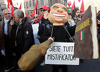 Manifestazione nazionale della CGIL a Roma, 27 novembre 2010, contro la politica economica del governo..A demonstrator wearing a mask representing the Italian premier Silvio Berlusconi hits a replica of the Italian Constitution with a foam rubber bludgeon during a rally promote by the italian CGIL main labor union against the government's economics policy, in Rome, 27 november 2010..UPDATE IMAGES PRESS/Riccardo De Luca