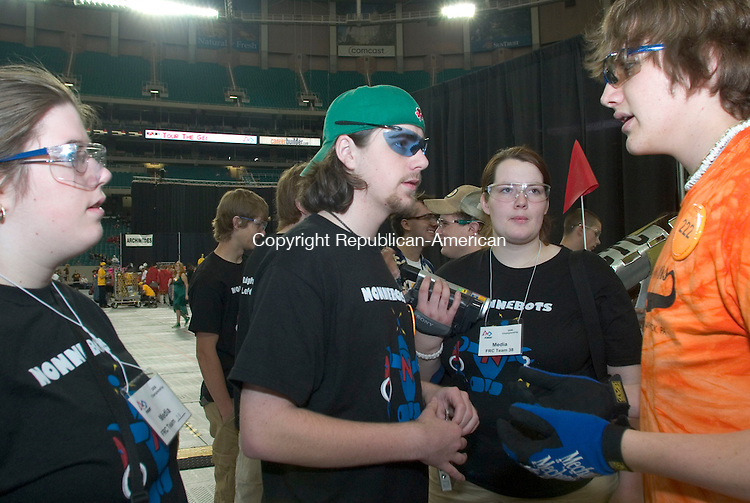 ATLANTA, GA- 29 APRIL 2006- 042906JT14-<br /> Patrick Fagan talks to Henry Sick of Tunkhannock, Pa. as Ashley Chabot, a mentor with the Nonnewaug robotics team, right, and Amanda Nichols, a team member, left, listen before a qualifying match in which their robot lost power at the 2006 FIRST Robotics Championship Saturday at the Georgia Dome in Atlanta. <br /> Josalee Thrift Republican-American