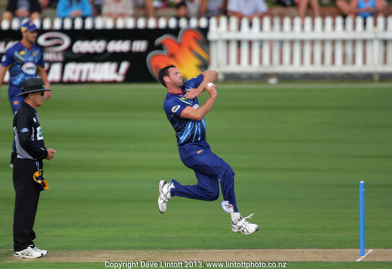 Ian Butler bowls during the HRV Cup Twenty20 cricket match between the Wellington Firebirds and Otago Volts at Hawkins Finance Basin Reserve, Wellington, New Zealand on Friday, 11 January 2013. Photo: Dave Lintott / lintottphoto.co.nz