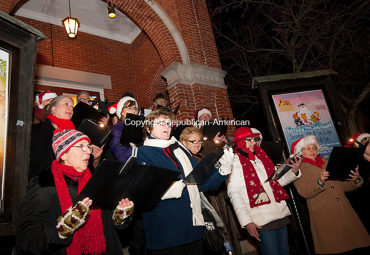 THOMASTON, CT--- -112815JS09--Members of the Waterbury Chorale sing holiday songs in front of the Thomaston Opera House during the annual Light Up Thomaston event Saturday in downtown Thomaston. <br /> Jim Shannon Republican-American
