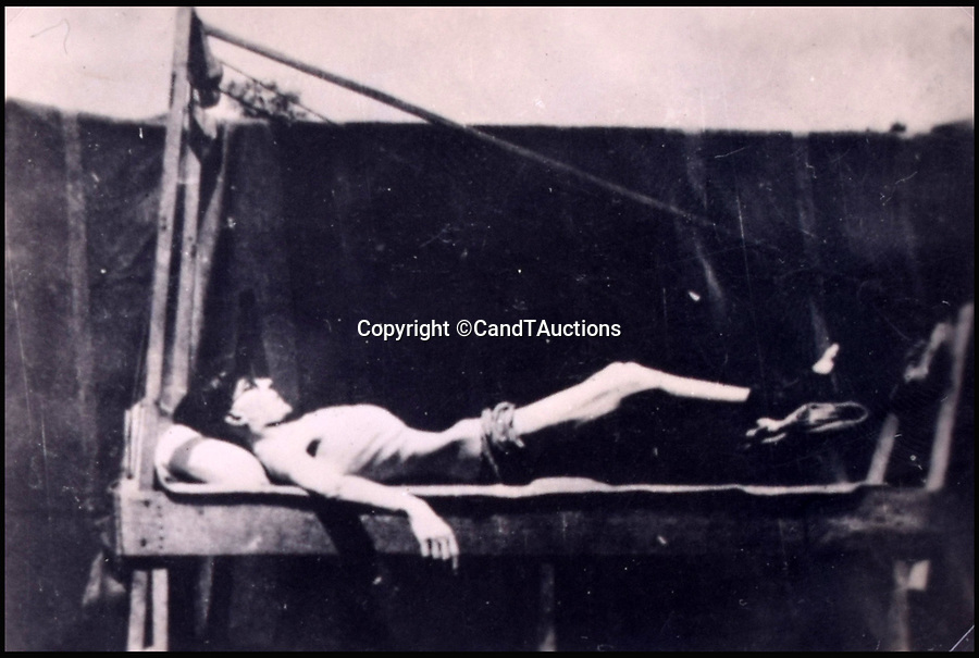 BNPS.co.uk (01202 558833)Pic: CandTAuctions/BNPS<br /> <br /> British prisoner of war being tortured<br /> <br /> Shocking photographs showing the skeletal state of British PoWs in Japan after they were liberated at the end of the Second World War have been unearthed.<br /> <br /> Hundreds of emaciated servicemen who had been starved and brutally beaten by their captors were found by Allied troops following the fall of Japan in 1945.<br /> <br /> Photographers were brought in to take pictures of the PoWs to be used as evidence for any potential war crimes trial.<br /> <br /> The images show gaunt and haggard men whose bodies have been reduced to skin and bone.<br /> <br /> There are also images of showing some of the most sadistic Japanese guards including the notorious camp commandment Lieutenant Usuki, who was known as the Black Prince.