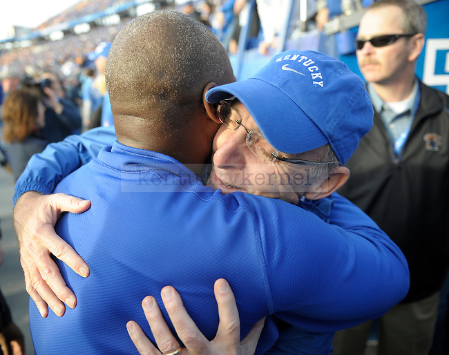 Kentucky Wildcats head coach Joker Phillips embraces University of Kentucky President Dr. Capilouto  after winning the University of Kentucky football game against Tennessee at Commonwealth Stadium in Lexington, Ky., on 11/26/11. Uk won the game 10-7. Photo by Mike Weaver   Staff