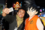 """A visitor takes a picture with Goku (Son Goku) the main protagonist of the Japanese manga series Dragon Ball at the Anime Japan 2015 on March 21, 2015 in Tokyo, Japan. Anime Japan 2015 brings together all aspects of the """"anime"""" industry offering an opportunity for visitors get close to creators, voice actors, idol groups, and cosplayers, and to learn about the industry. This is the second year that the exhibition is being held at Tokyo Big Sight. Organizers estimated that approximately 100,000 visitors attended in 2014 and similar huge numbers are expected this year. The exhibition is open on March 21st and 22nd. (Photo by Rodrigo Reyes Marin/AFLO)"""