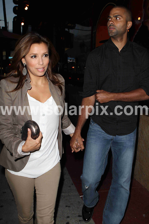 **ALL ROUND PICTURES FROM SOLARPIX.COM**.**SYNDICATION RIGHTS FOR UK AND SPAIN ONLY**.American actress Eva Longoria, star of TV series Desperate Housewives, and her husband Tony Parker were pictured heading to the Laugh Factory on Sunset Blvd in West Hollywood, California, to catch a comedy show. LA, USA. 25 May 2010.This pic: Eva Longoria Parker and Tony Parker..JOB REF: 11335 PRT        DATE: 25_05_2010.**MUST CREDIT SOLARPIX.COM OR DOUBLE FEE WILL BE CHARGED**.**MUST NOTIFY SOLARPIX OF ONLINE USAGE**.**CALL US ON: +34 952 811 768 or LOW RATE FROM UK 0844 617 7637**