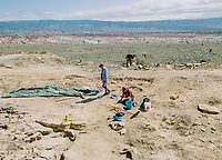 Students and Paleontologists from the University of Manchester in England and the Natural History Museum of England at a the Jurassic Mile dinosaur dig site in the Big Horn Basin in Wyoming, June 29 - July 2, 2019. The dig is led by Phillip L. Manning, a paleontologist at the University of Manchester in England.<br />  <br /> Photo by Matt Nager
