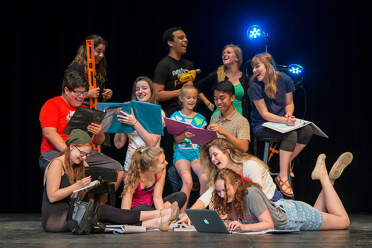 Students pose for photographs at the High School for Performing and Visual Arts, August 12, 2014.