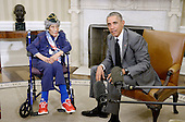 United States President Barack Obama, right, meets with 110-year-old Emma Didlake of Detroit, Michigan, the nation's oldest living veteran, who served as a highly decorated private in the Women's Army Auxiliary Corps (WAAC) during World War II, in the Oval Office of the White House in Washington, DC on July 17, 2015.  Pvt Didlake is visiting Washington, DC, for her Honor Flight, provided by the Honor Flight Network.<br /> Credit: Olivier Douliery / Pool via CNP