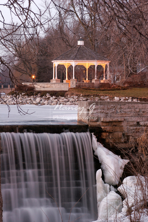 A gazebo in the park along the mill pond and waterfall in Midwest America, Menomonee Falls Wisconsin
