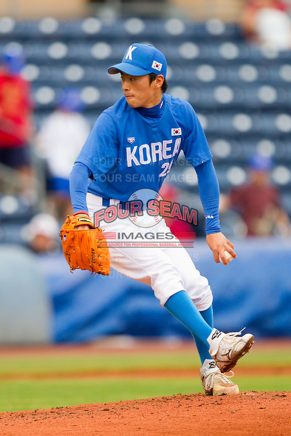 Ji-Woong Yoon #29 of Team Korea in action against Team USA at Durham Bulls Athletic Park July 18, 2010, in Durham, North Carolina.  Photo by Brian Westerholt / Four Seam Images