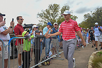 Jordan Spieth (USA) high fives some young fans as he departs the 10th tee during day 3 of the World Golf Championships, Dell Match Play, Austin Country Club, Austin, Texas. 3/23/2018.<br /> Picture: Golffile | Ken Murray<br /> <br /> <br /> All photo usage must carry mandatory copyright credit (&copy; Golffile | Ken Murray)