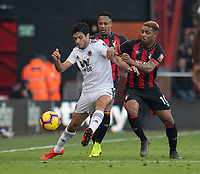 Bournemouth's Junior Stanislas (right) battles with Wolverhampton Wanderers' Raul Jimenez (left) <br /> <br /> Photographer David Horton/CameraSport<br /> <br /> The Premier League - Bournemouth v Wolverhampton Wanderers - Saturday 23 February 2019 - Vitality Stadium - Bournemouth<br /> <br /> World Copyright © 2019 CameraSport. All rights reserved. 43 Linden Ave. Countesthorpe. Leicester. England. LE8 5PG - Tel: +44 (0) 116 277 4147 - admin@camerasport.com - www.camerasport.com