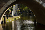 A walkway framed by a canal bridge in Utrecht, the Netherlands.