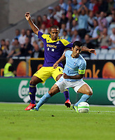 Thursday 08 August 2013<br /> Pictured L-R: Wayne Routledge of Swansea challenging Jiloan Ahmad of Malmo. <br /> Re: Malmo FF v Swansea City FC, UEFA Europa League 3rd Qualifying Round, Second Leg, at the Swedbank Stadium, Malmo, Sweden.