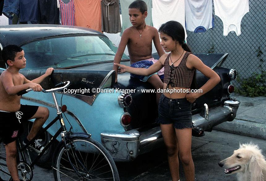 Kids in front of a 1956 Dodge Royal in Havana, Cuba in 1998.