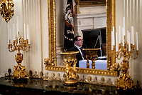United States Secretary of the Treasury Steven T. Mnuchin is reflected in a mirror during a roundtable discussion with industry leaders on reopening the American economy in the State Dining Room of the White House in Washington, DC on May 29, 2020. <br /> Credit: Erin Schaff / Pool via CNP/AdMedia