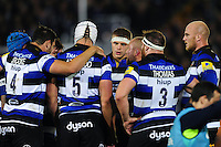The Bath Rugby forwards huddle together during a break in play. Aviva Premiership match, between Bath Rugby and Sale Sharks on October 7, 2016 at the Recreation Ground in Bath, England. Photo by: Patrick Khachfe / Onside Images