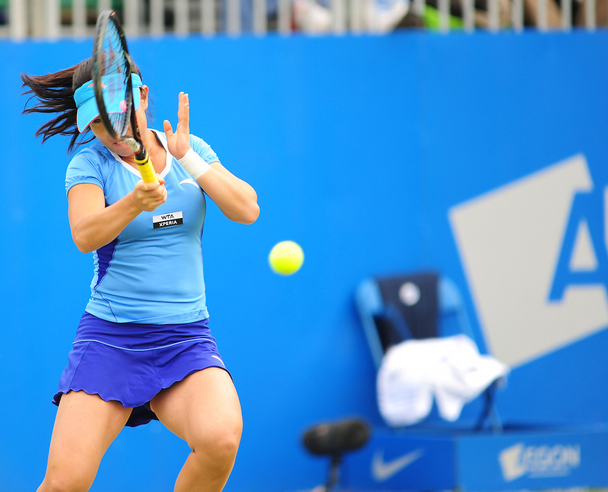 Jie Zheng CHN in action during her defeat by Jelena Jankovic SRB [4] in their Women's Singles Semifinal match - Jelena Jankovic SRB [4] def Jie Zheng CHN 6-7(2) 7-5 6-1..International Womens Tennis - 2012 WTA Tour - The AEGON Classic - Edgbaston Priory Club - Birmingham - Day 7 - Sunday 17th Jun 2012..