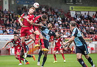 Matt Harrold of Crawley Town heads clear during the Sky Bet League 2 match between Crawley Town and Wycombe Wanderers at Checkatrade.com Stadium, Crawley, England on 29 August 2015. Photo by Liam McAvoy.