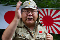 An older Japanese man in Imperial Army uniform lectures a crowd on history as Yasukuni shrine marks the 72nd anniversary of the end of the Pacific War. Yasukuni Shrine, Kudanshita, Tokyo Japan. Tuesday August 15th 2017. Nominally a event to honour Japan's war dead and call for continued peace, this annual gathering  at Tokyo's controversial Yasukuni  Shine also allows many Japanese nationalists to display their nostalgia for their Imperial past.Rightwing paramilitary groups, Imperial cos-players, politicians and many ordinary citizens come together at the shrine to march and wave flags. The day goes almost unreported in the mainstream Japanese media.