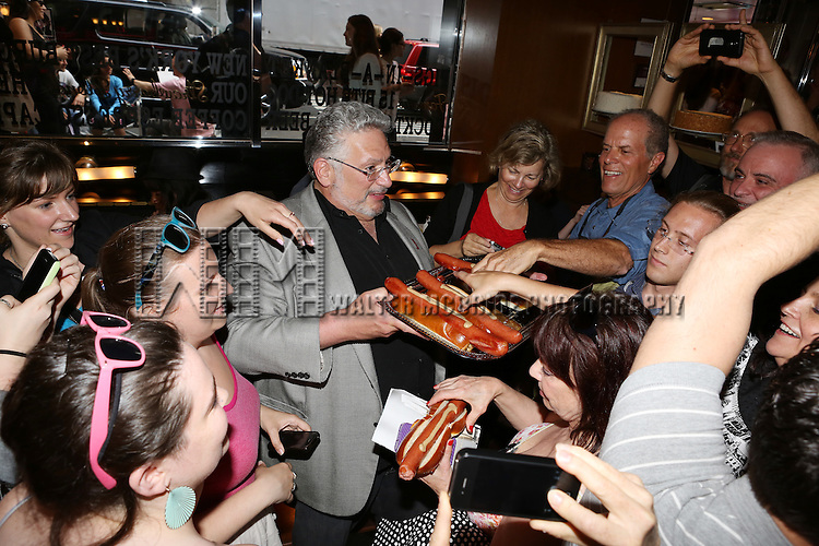 Brooklyn's own Harvey Fierstein receives the Brooklyn Diner's Highest Honor with the dedication and serving of their '15 Bite 'All Beef' Harvey Hot Dog' at the Brooklyn Diner in Times Square, New York City on May 22, 2013.