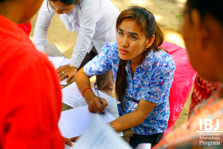 Villagers sign document to show their attendance to Street Law in Pursat.