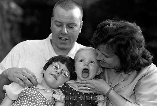 Hutchison family portraits. Warren Hutchison, Becky Hutchison, Anna Hutchison, Jamie Hutchison.<br />