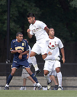 Boston College defender/forward Kevin Mejia (12) heads the ball on a corner kick. Boston College defeated Quinnipiac, 5-0, at Newton Soccer Field, September 1, 2011.