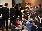 December 27, 2016, Tokyo, Japan - Japan's troubled electronics giant Toshiba president Satoshi Tsunakawa (3rd L) leaves a press conference as he annonces the company may post several billion US dollars loss for the fiscal year in connection with Toshiba's subsidiary Westinghouse's nuclear plant business in the U.S. at Toshiba headquarters in Tokyo on Tuesday, December 27, 2016.  (Photo by Yoshio Tsunoda/AFLO) LWX -ytd-