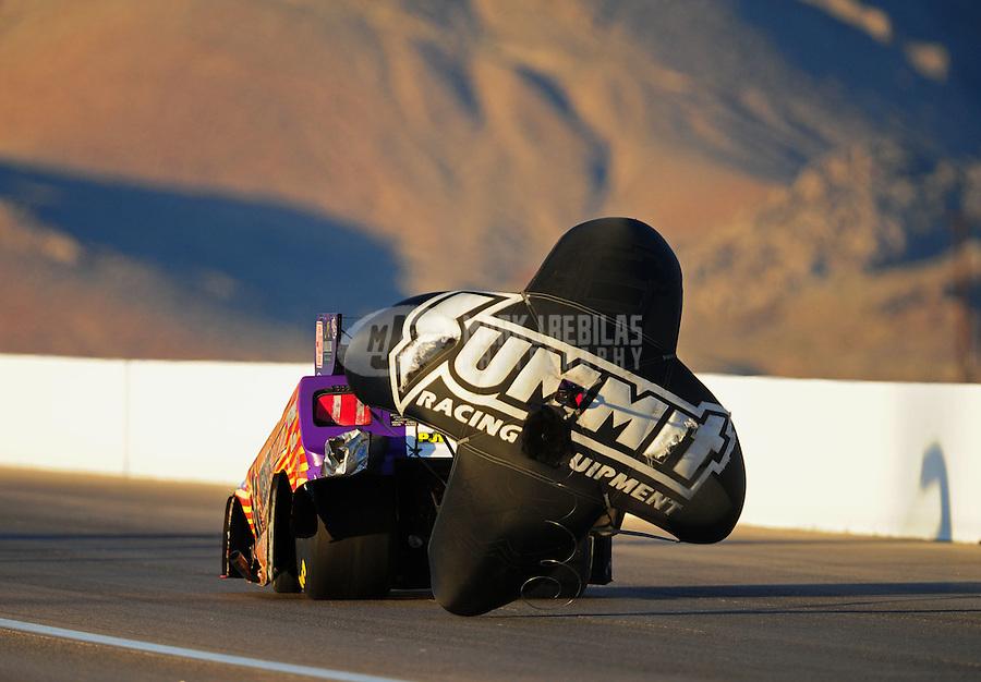 Oct. 28 2011; Las Vegas, NV, USA: NHRA funny car driver Tim Wilkerson during qualifying for the Big O Tires Nationals at The Strip at Las Vegas Motor Speedway. Mandatory Credit: Mark J. Rebilas-US PRESSWIRE