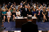 Associate Justice of the Supreme Court-designate Brett Kavanaugh raises his hand to be sworn in by United States Senate Judiciary Committee Chairman Chuck Grassley (Republican of Iowa) to testify during his confirmation hearing on Capitol Hill in Washington, U.S., September 4, 2018. <br /> Credit: Jim Bourg / Pool via CNP