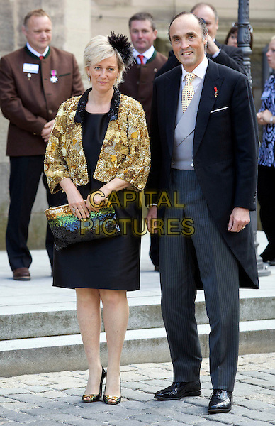 PRINCESS ASTRID & PRINCE LORENZ OF BELGIUM.Wedding of Hereditary Prince Hubertus of Sax -Coburg and Gotha and Kelly Rondestvedt in Coburg, Germany, .23rd May 2009..marriage royal full length gold jacket black dress suit clutch bag bronze .CAP/PPG/JH.©Jens Hartmann/People Picture/Capital Pictures