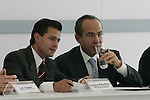 Mexican President Felipe Calderon (R) talks with Mexico State governor Enrique Pena Nieto during the inauguration of the new Bimbo bread-plant at Toluca City, September 14, 2007. Photo by Javier Rodriguez