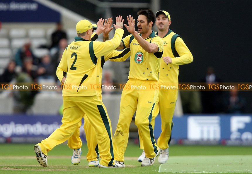 Mitchell Johnson of Australia celebrates after taking the wicket of Kevin Pietersen - England vs Australia, Natwest Series One Day International Cricket at Edgbaston - 11/09/13 - MANDATORY CREDIT: Rob Newell/TGSPHOTO - Self billing applies where appropriate - 0845 094 6026 - contact@tgsphoto.co.uk - NO UNPAID USE