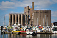 Canada Malting Co. grain processing tower is pictured behind a marina in Toronto April 22, 2010. The tower is part of the earlier industrial era of Toronto heritage, concentrated along the Toronto Harbour and lower Don River mouth.