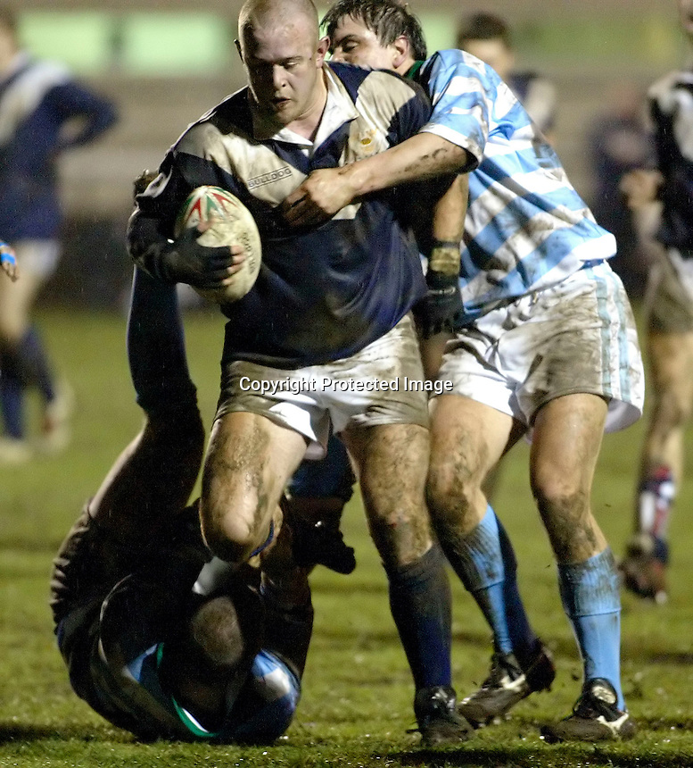 Cambridge University / Oxford University..Pcubed 23rd Rugby League Varsity match..The Athletic Ground, Richmond, March 5, 2003..Pic : Max Flego... Oxfords Joe Clark powers through the heart of the Cambridge defence