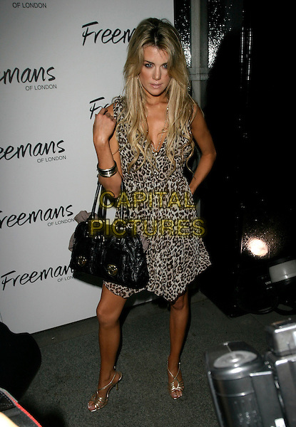 GUEST.Ashlee Simpson's birthday party at the Embassy Club, London, UK..October 11th, 2006 .Ref: AH.full length leopard print dress black bag purse.www.capitalpictures.com.sales@capitalpictures.com.©Adam Houghton/Capital Pictures.