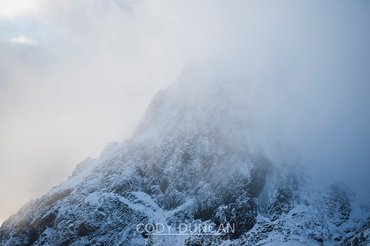 Mountain peak emerges from cloud, Lofoten Islands, Norway