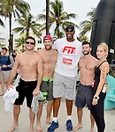 MIAMI BEACH, FLORIDA - APRIL 03: Scott Eastwood, Geoff Stults, Jason Collins, Parker Young and Claire Holt participates in Life Time South Beach Triathlon benefiting the St. Jude Children Hospital at Lummus Park on Sunday April 3, 2016 in Miami Beach, Florida. ( Photo by Johnny Louis / jlnphotography.com )