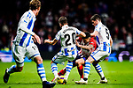 Angel Correa of Atletico de Madrid (C) fights for the ball with Igor Zubeldia of Real Sociedad (R) during the La Liga 2018-19 match between Atletico de Madrid and Real Sociedad at Wanda Metropolitano on October 27 2018 in Madrid, Spain.  Photo by Diego Souto / Power Sport Images