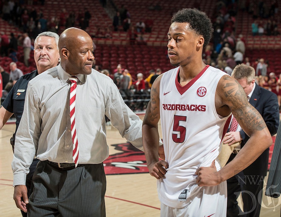 NWA Democrat-Gazette/ANTHONY REYES &bull; @NWATONYR<br /> Arkansas head coach Mike Anderson and Arkansas Razorbacks guard Anthlon Bell (5) walk off the court after losing to Auburn in the second half Wednesday, Feb. 17, 2016 at Bud Walton Arena in Fayetteville. The Razorbacks lost 90-86.