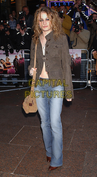 AMY STUDT.Atending the Gala Celebrity Premiere of movie Seeing Double at the Odean Cinema, Leicester Square, London..April 7th 2003.full length full-length curly hair.Ref: BEL.www.capitalpictures.com.sales@capitalpictures.com.©Capital Pictures