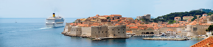 Stock photos of Dubrovnik Old town - View of the city walls and sea with a cruise liner